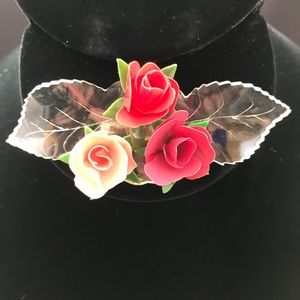 Vintage plastic rose brooch